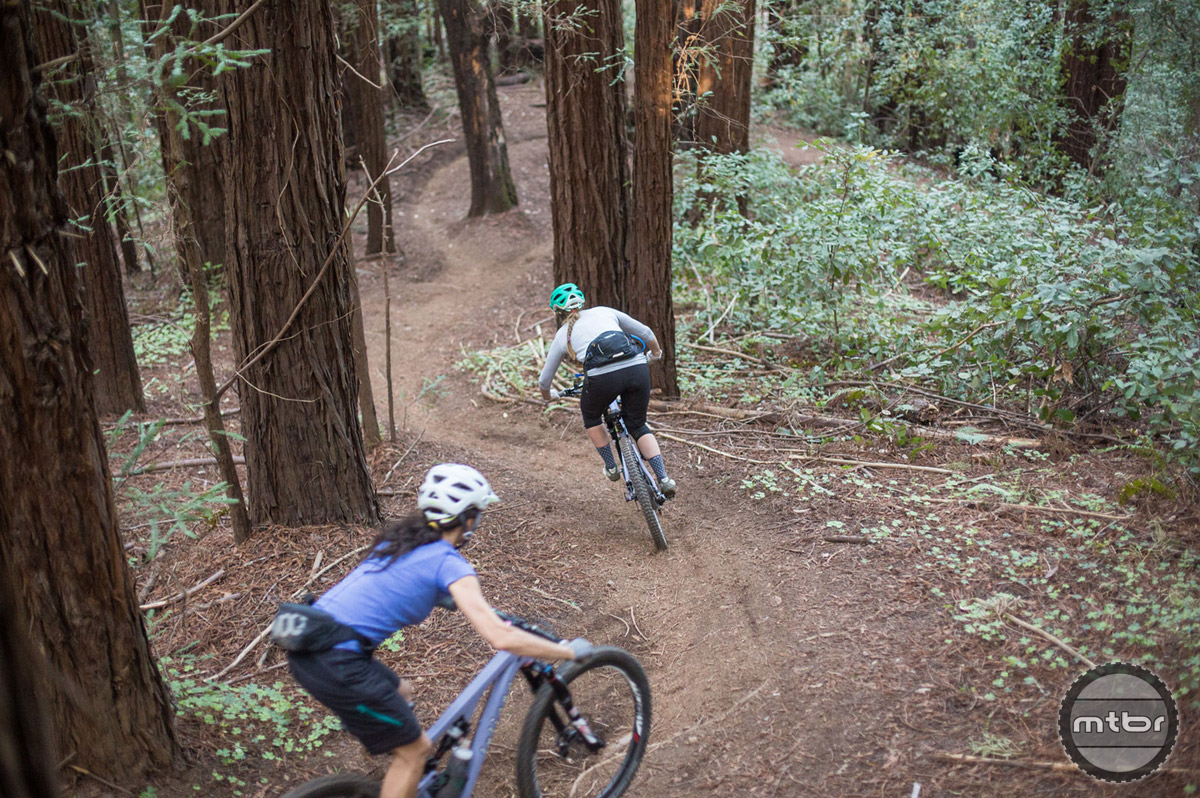 Juliana-SRAM pro team riders Kelli Emmett and Sarah Leishman on the Emma McCrary Trail in Santa Cruz, CA. Photo by Mike Thomas/SCB