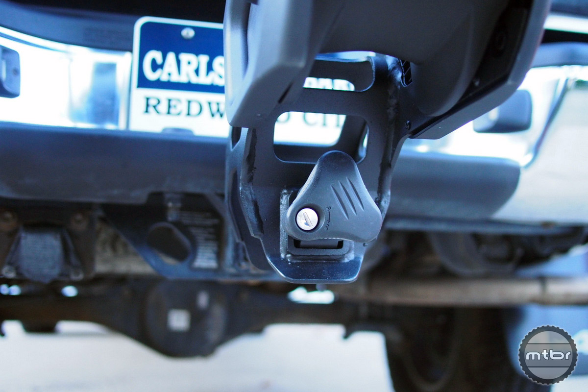The rack is held securely by an expanding hitch cam system tightened with this knob.