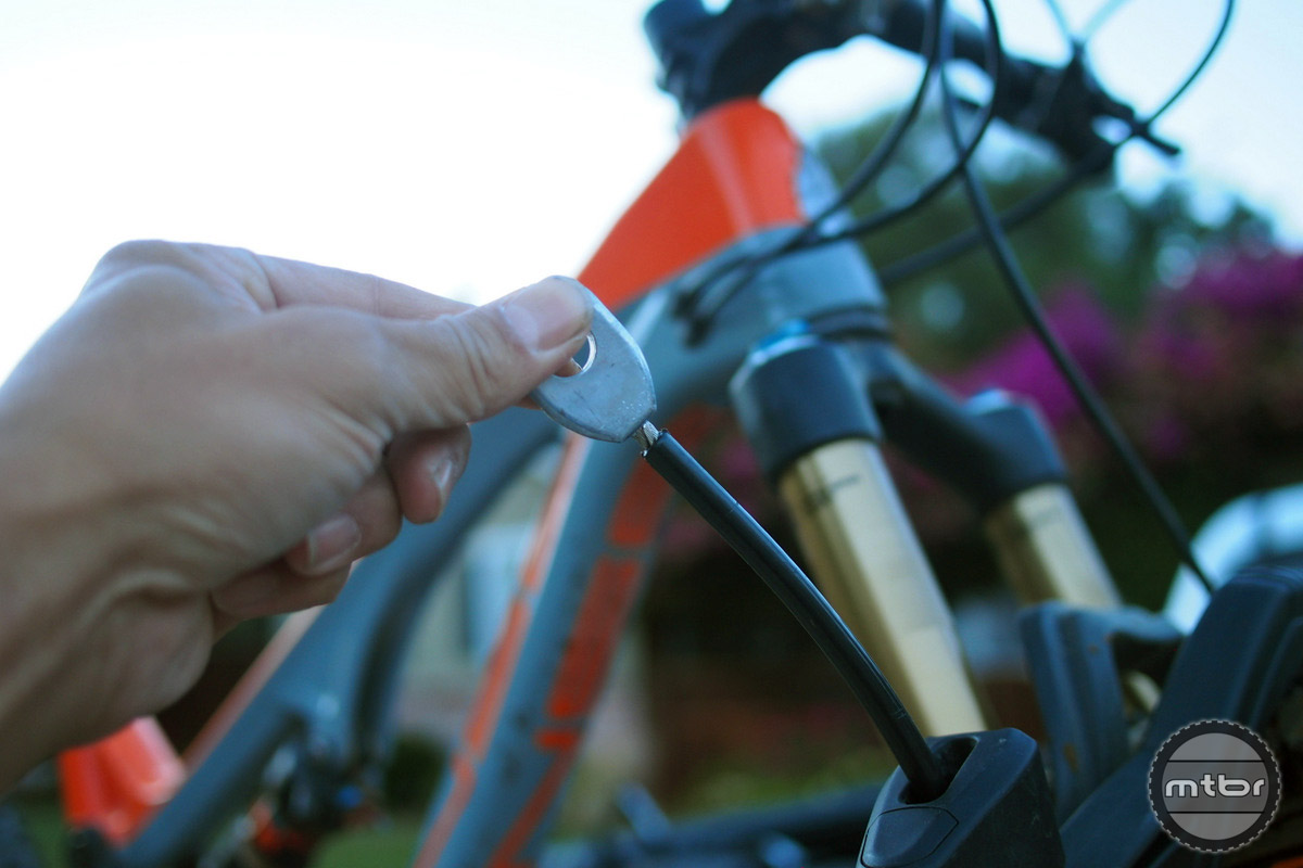 The bike lock cable is beefy and has a spring loaded return to keep it from dangling into the road while driving.