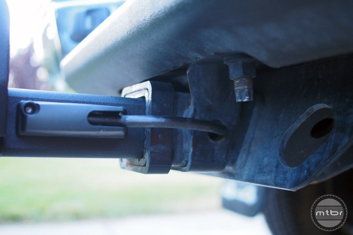 A spring loaded hitch pin is part of the rack and can never get lost.
