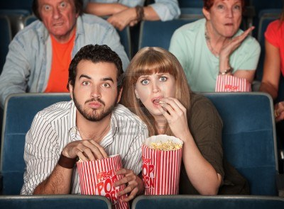 Name:  12365056-scared-caucasian-couple-eating-popcorn-in-theater.jpg