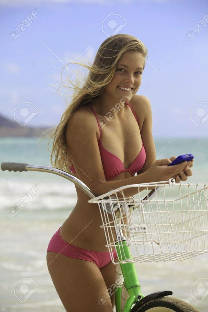 Rate my Ride-14638618-girl-bikini-texting-cell-phone-beach-bike.jpg