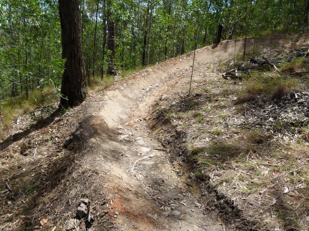 Decreasing Radius turns that steepen? good or bad trail design?-18-big-berm-below-after.jpg
