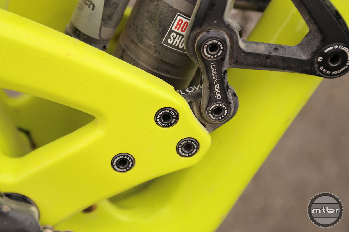 Integrated flip chips in the linkage allow the bike to be adjusted between low and high settings.