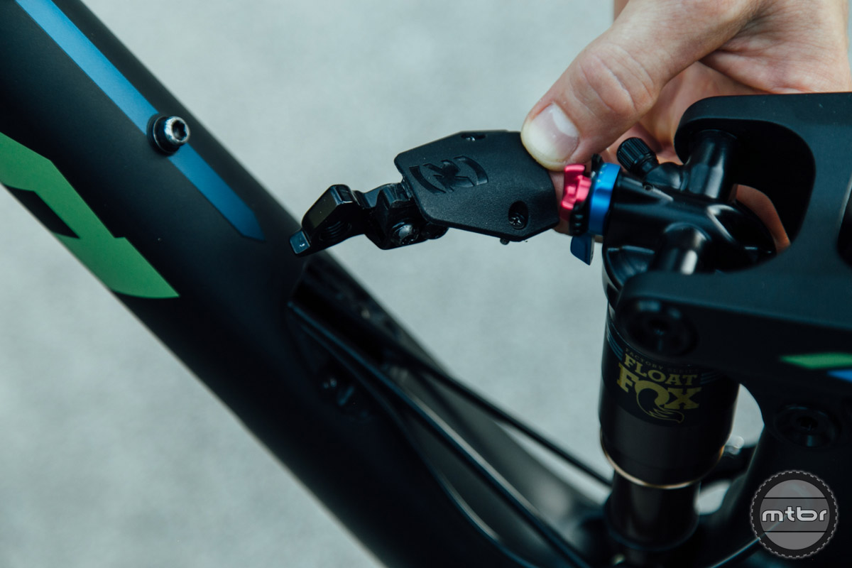 The spare rear hanger that hides within the downtube cover also doubles as a cable guide, to help prevent things from rattling around.