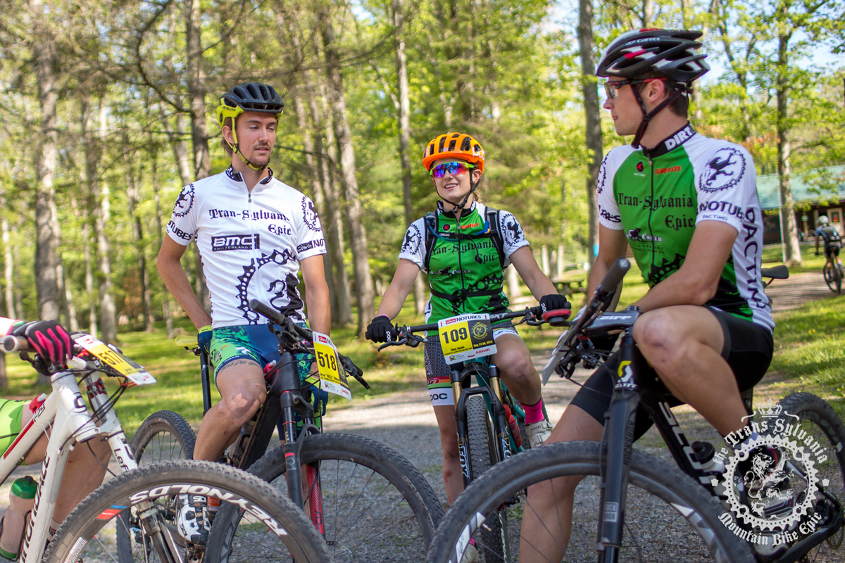 Drew Dillman (Colt Training Systems | Red Team), Jason Blodgett (Colt Training Systems | White Team), and Ellen Noble (Competitive Cyclist) proudly wear their leaders jerseys. Photo by the Trans-Sylvania Epic Media Team