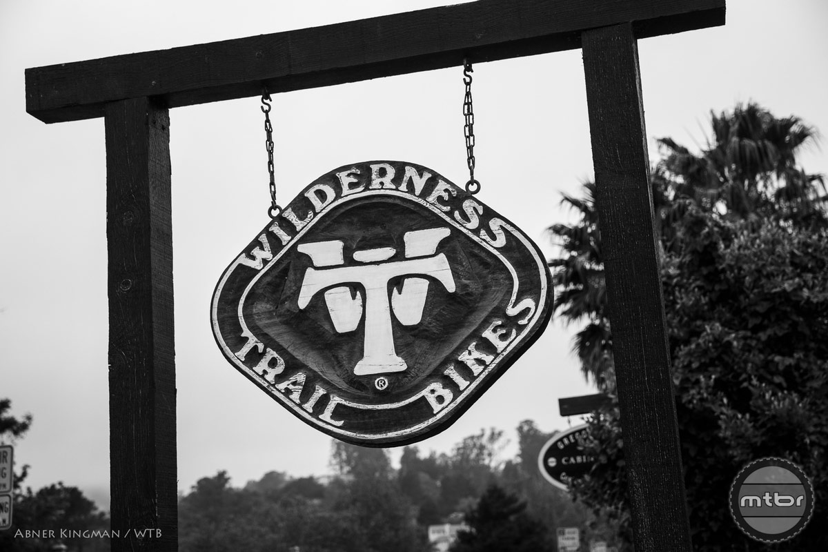 Hanging wooden sign. Photo by Abner Kingman
