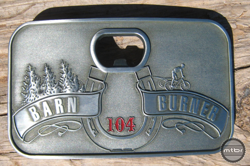 The buckle is available for 104 mile competitors. The large buckle is for athletes who finish under 9 hours and the small buckle is for under 11 hour finishers.