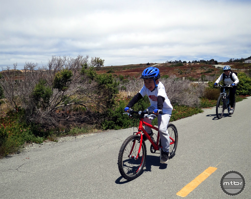 Our young rider is battling a head wind here, but smiles and dreams of pizza at the end of the ride nonetheless.