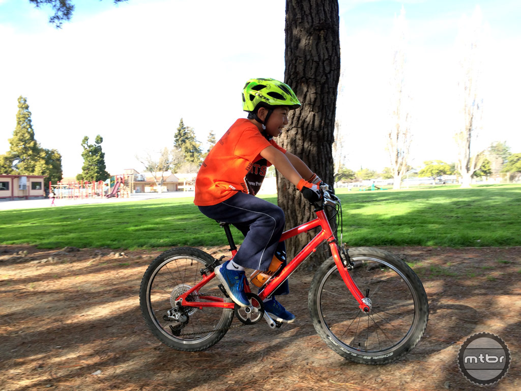 This side view shows that the seating position strikes a good balance of forward weight placement without being too extreme for less committed types of rides. The water bottle cage provides enough room for young riders to take the bottle out themselves, but be sure they practice at a standstill first.
