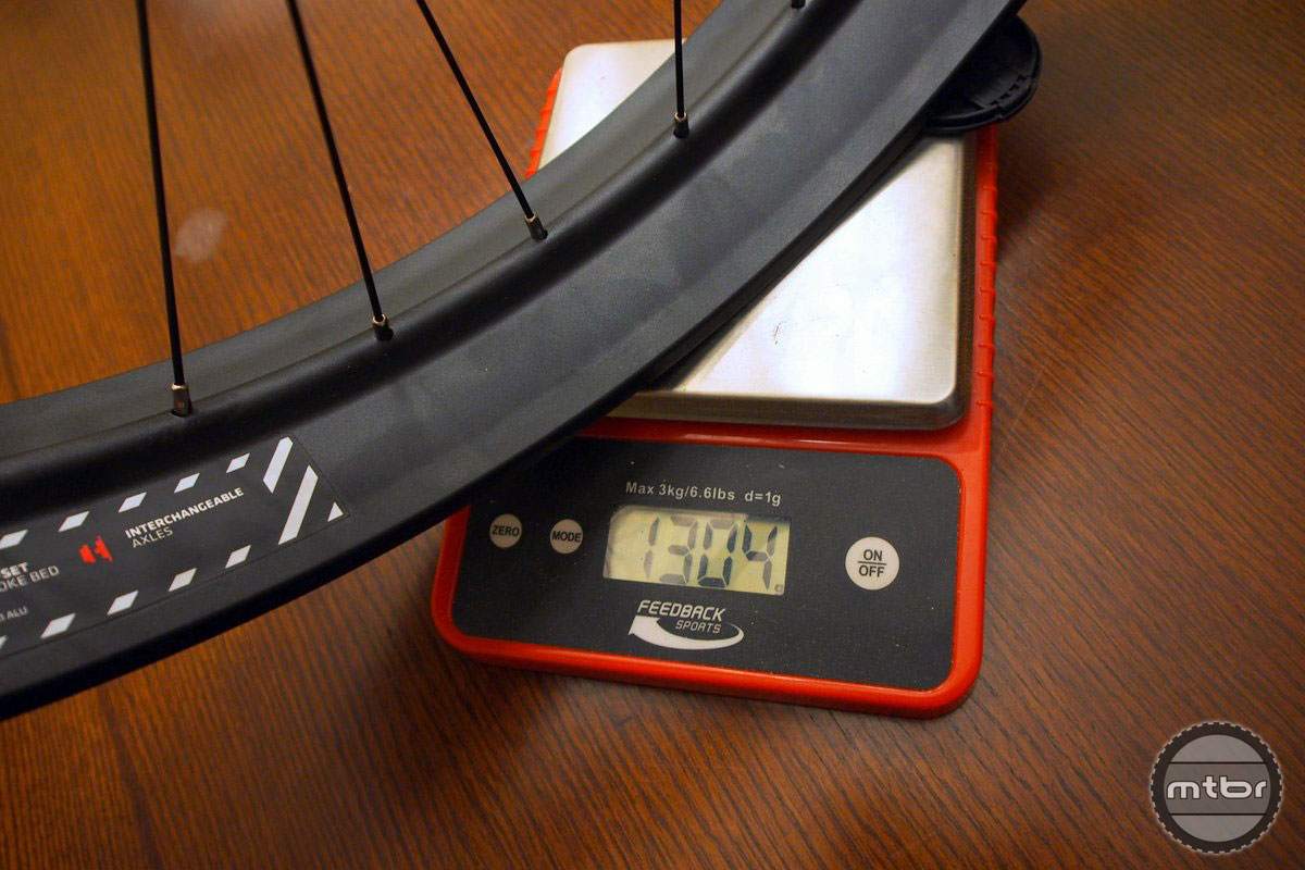 Weight is 1304g on our scale for the QR front and 1552g for the rear wheel.