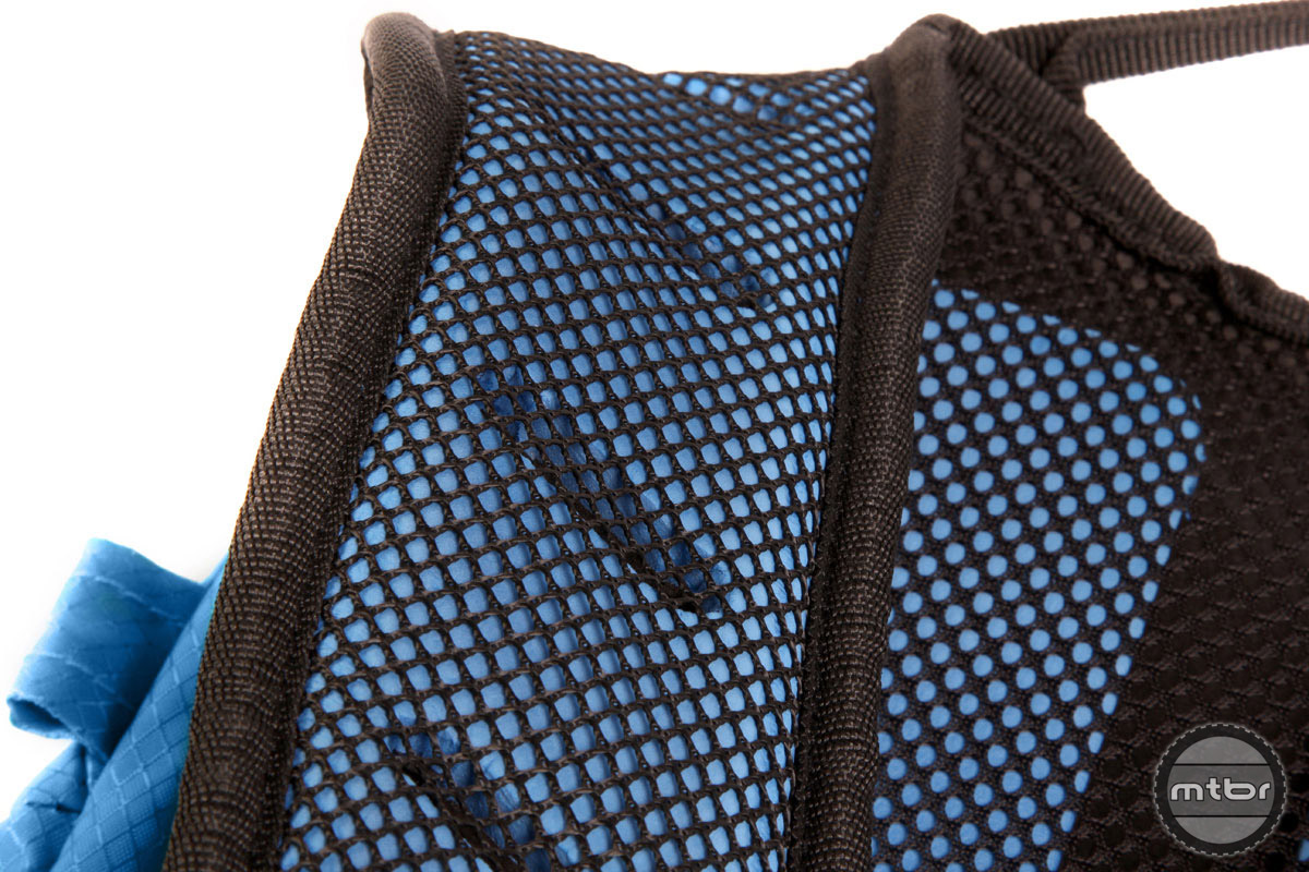 Pre-shaped, lightweight perforated foam shoulder strap construction provides comfort and ventilation.