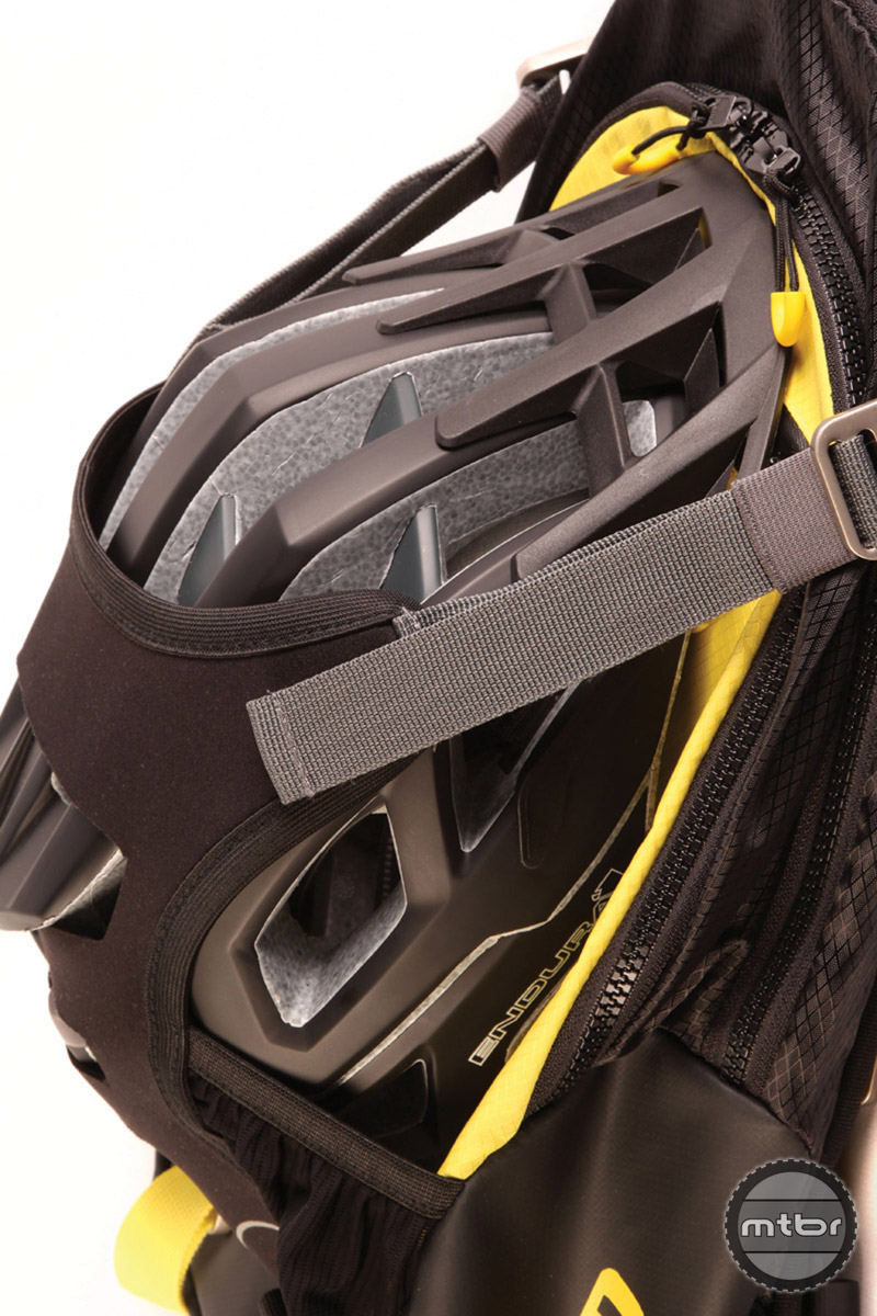 Features include an Adaptive Helmet Carry System for full face and standard helmets.