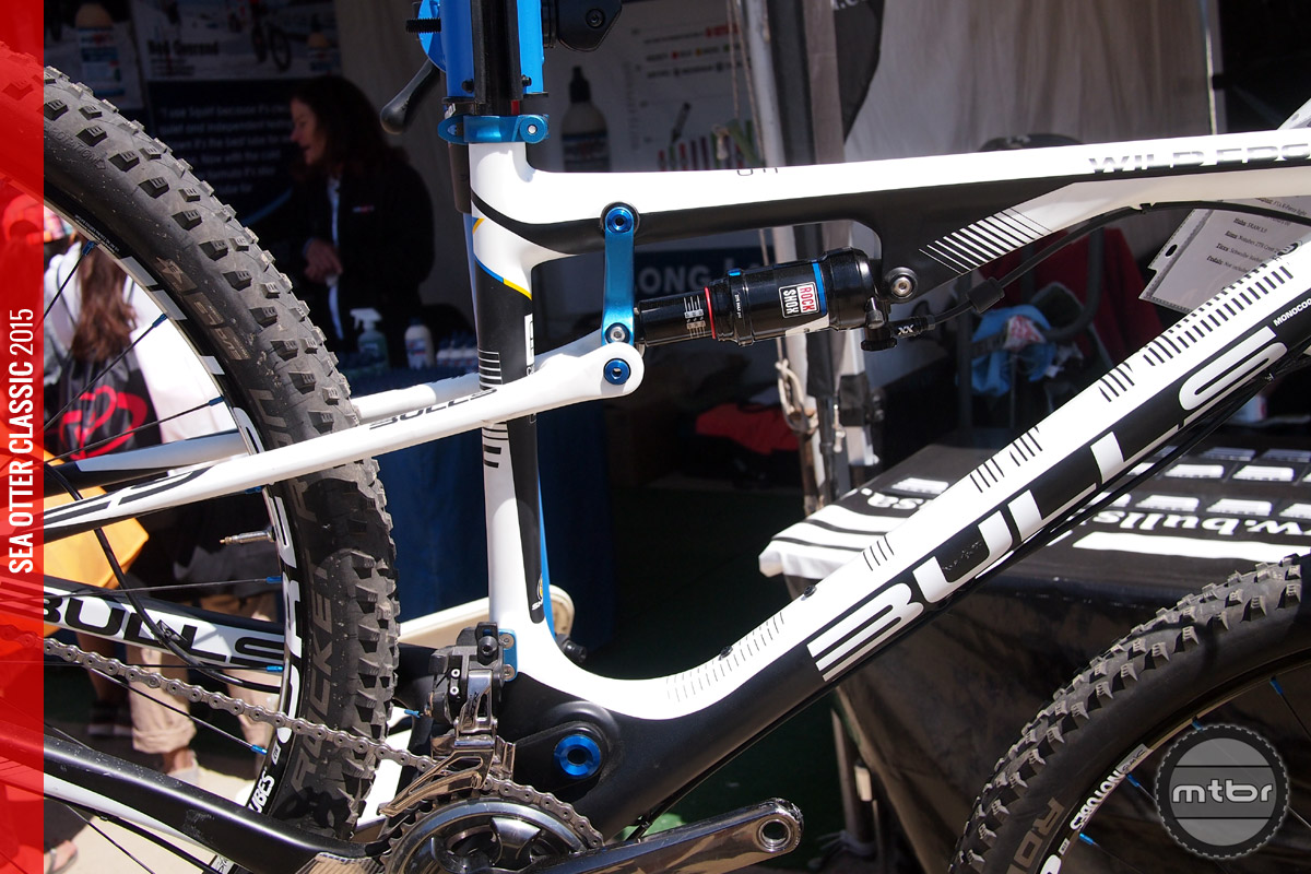 The rear suspension design uses a top tube mounted shock with a swing link to provide 100mm of travel.