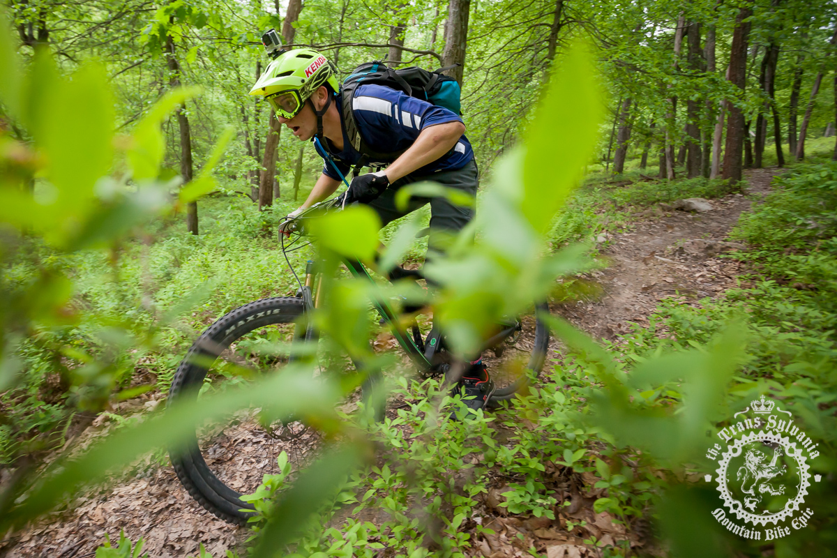 Cody Phillips is riding through the woods during the enduro stage. Photo by Harris Dunlap and A.E. Landes of the Trans-Sylvania Epic Media Team