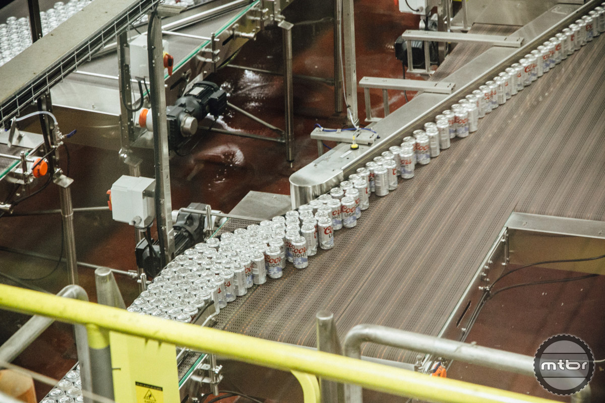 As cans are filled, they are sorted into various lines for retail packaging.