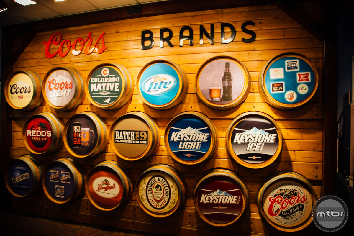This wall showcases just a small number of the beers brewed at this facility.