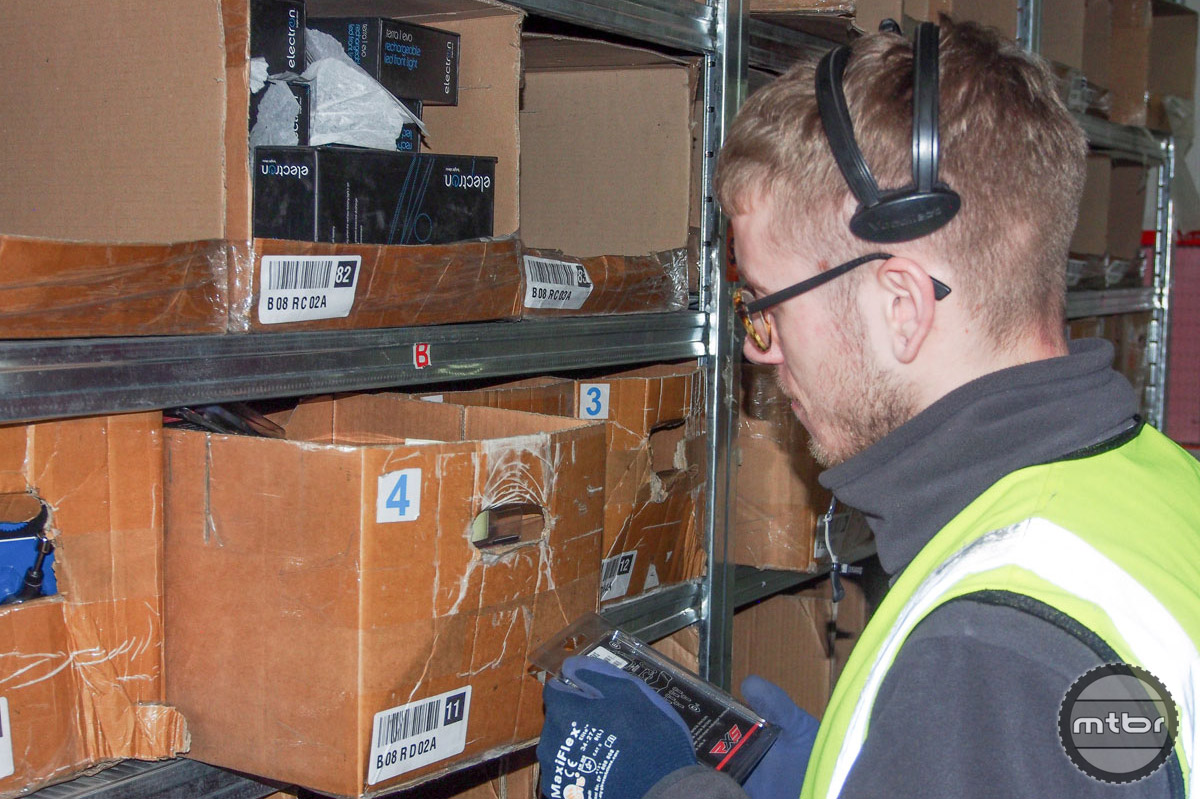 With direction from above, order fillers efficiently put together product.