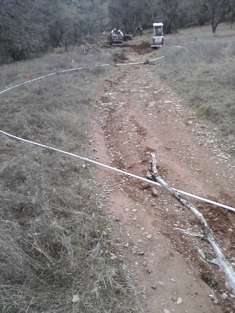 How to build a Culvert Trail berm just right!-culvert_flow_sticks.jpg
