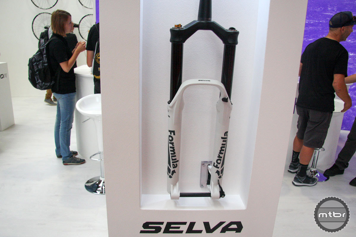 Italy's Formula showed the new Selva enduro oriented fork. It comes in travel from 120mm to 180mm for 27.5, 27.5 plus, and 29er. Highlight features include a remote cartridge control that puts high speed compression control on the handlebars with 13 positions from open to locked. This bump absorber also utilizes hexagon-shaped stanchions that are designed to increase stiffness. Color choices include black, white, and purple.