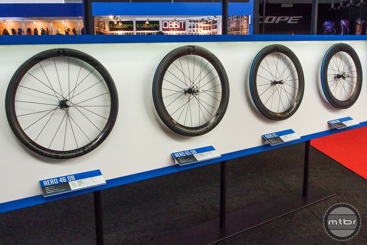 Reynolds has new aero road wheels in three depths 46mm, 65mm, and 80mm. The  revised rim shape is claimed to save 3-4 watts and they are all tubeless ready. No brake track and disc only on 46mm depth. The 65mm comes in both rim and disk. The 80mmis rim brake only for the tri and TT market. Price is $2599 for disc and $2499 for the rim brake set-ups. Graphics are water slide so they don't affect aero performance and wont peel off. Availability is set for January.