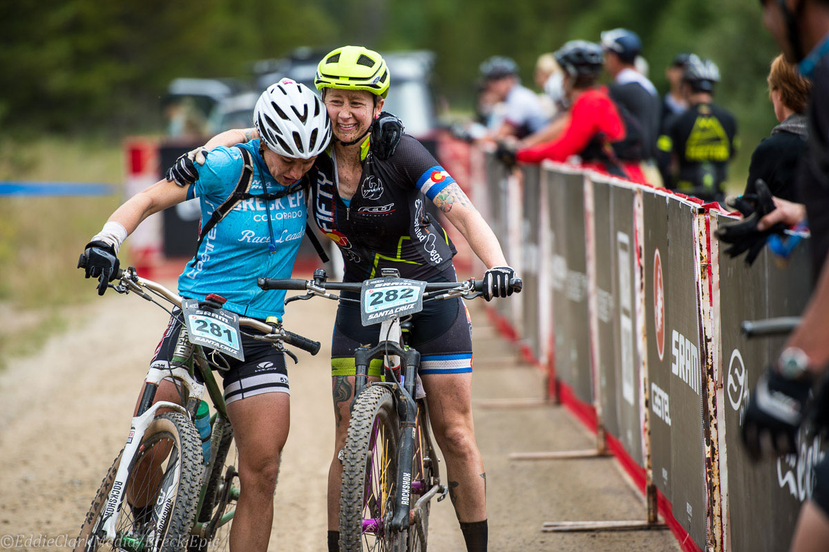 Race leader Sara Sheets and 92fifty rider Andrew Wilson congratulate each other at the finish line. Photo courtesy Breck Epic/Eddie Clark