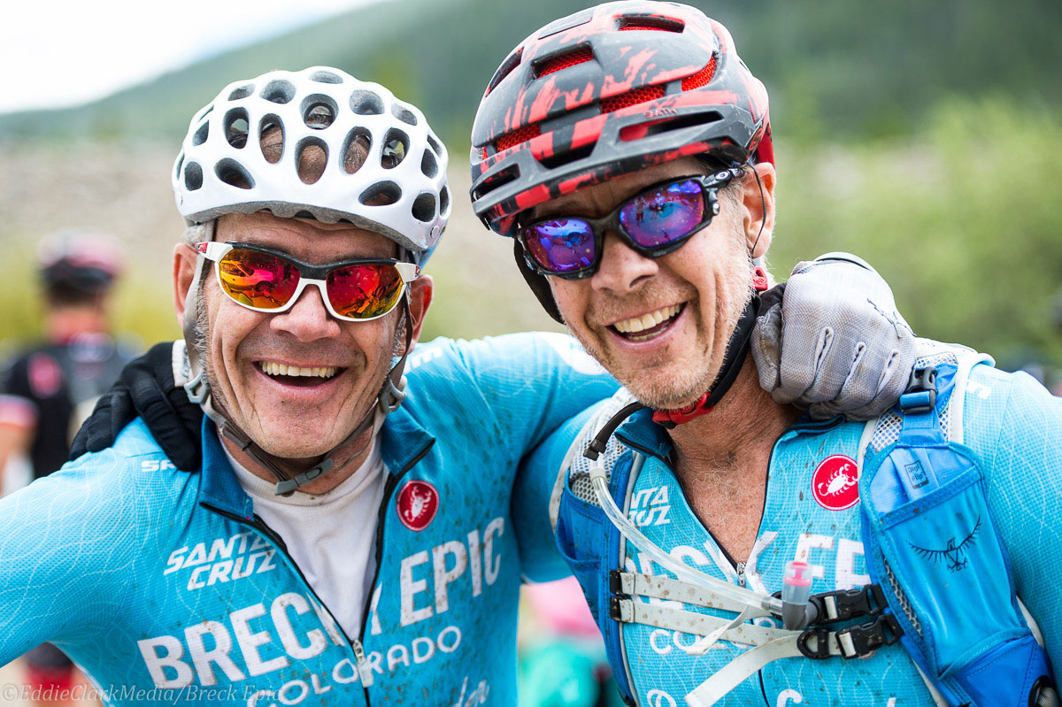 Deadgoat teammates from Calgary Tim Breznyak and Darrell Jones enjoy a man hug after Breck Epic's Colorado Trail stage. Photo courtesy Breck Epic/Eddie Clark