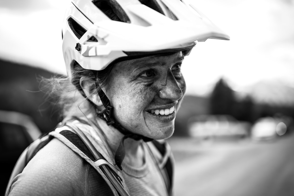 Women's 6 day open leader Amy Krahenbuhl cracks a smile of reprieve after another stage win. Photo by Eddie Clark