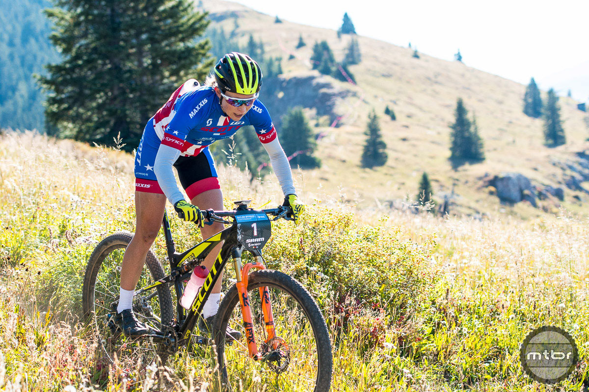Current US national champion Erin Huck took a repeat win aboard her Scott Spark.  Huck runs a 1x11 Shimano XTR Di2 drivetrain with XTR brakes. The bars and seatpost are carbon Syncros, and the stem is an alloy Syncros. Photo by Eddie Clark