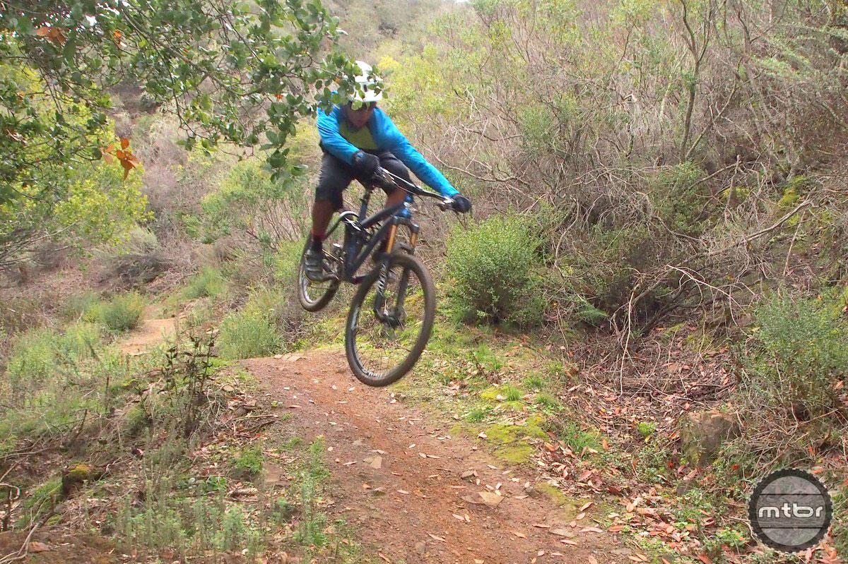 Bike jump on a fun, techy local trail.