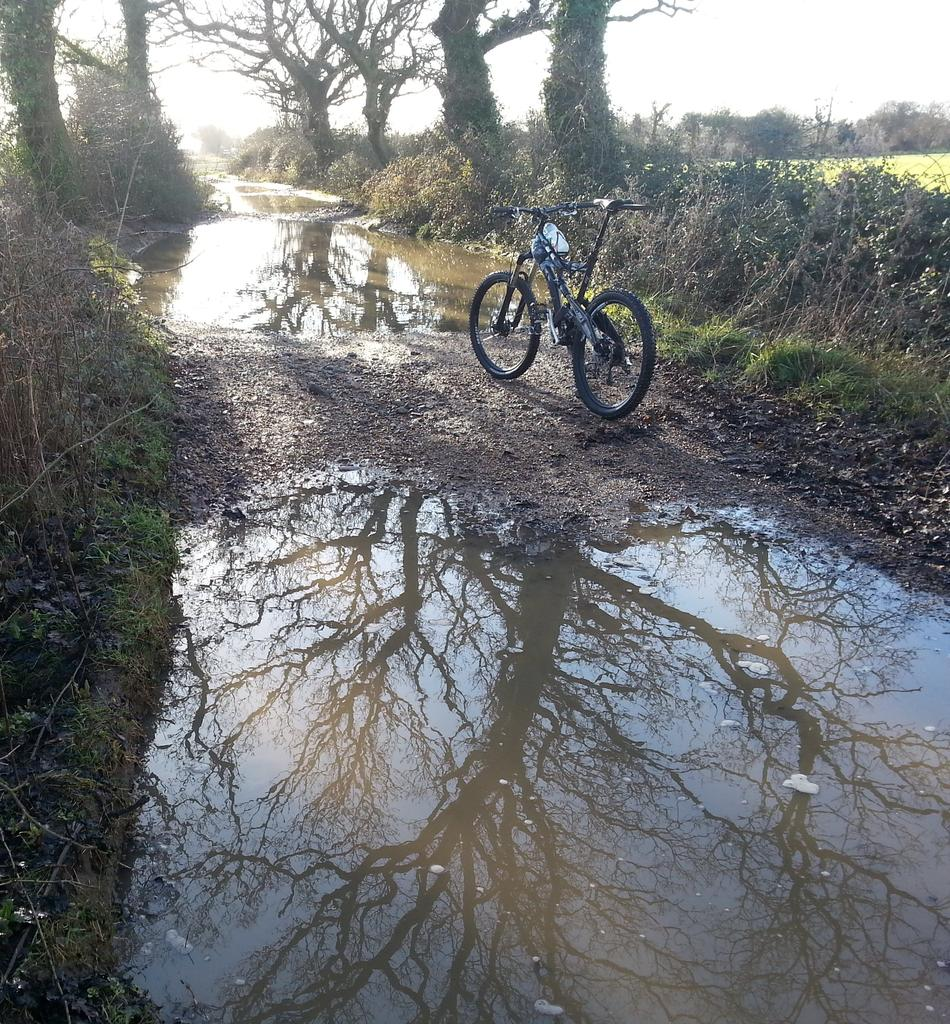 One picture, one line.  No whining. Something about YOUR last ride. [o]-farm-track-pond.jpg