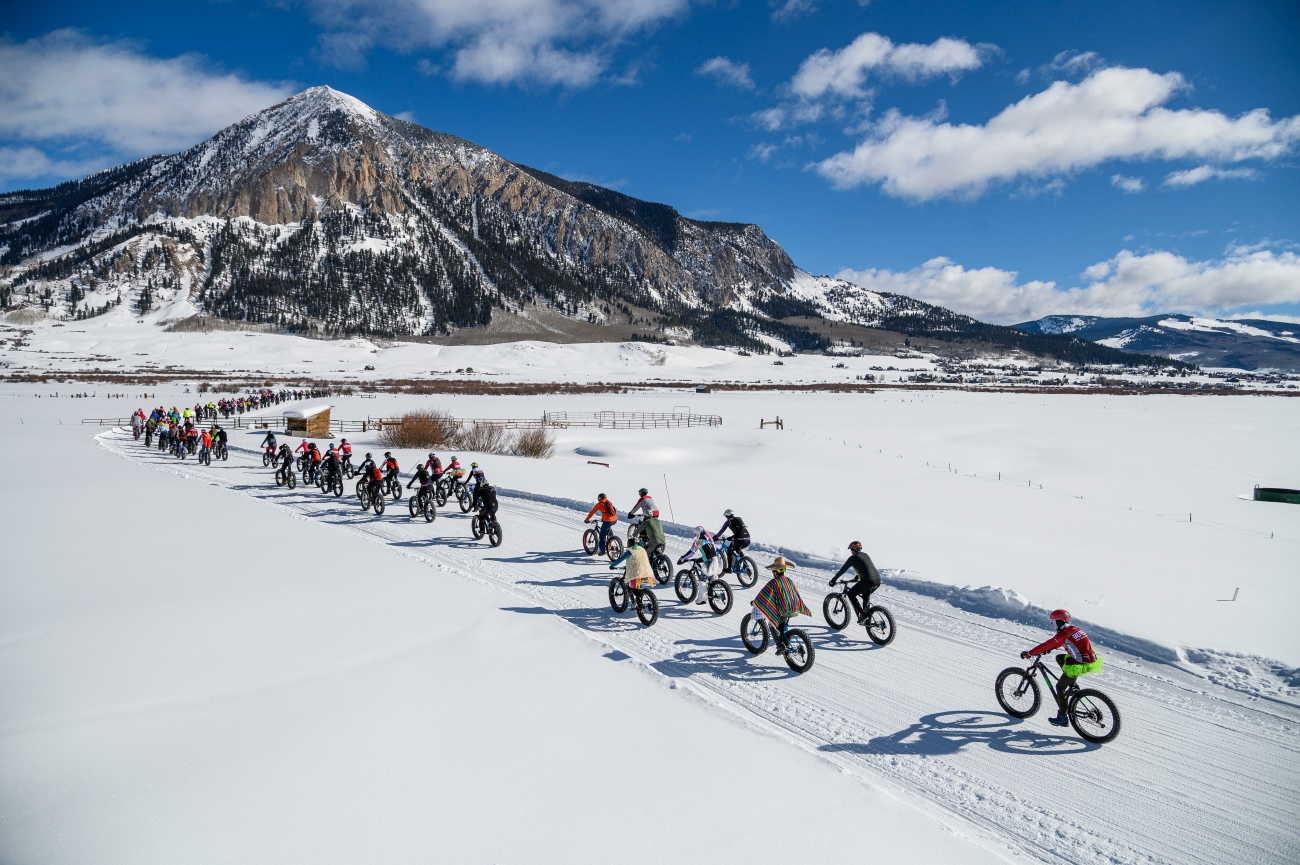 Off they went at the Fat Bike World Championships. The fast folks whipped around the 5-mile course in around 20 minutes per lap, while casual contestants stopped for whiskey shots and bacon hand-ups, and may or may not have finished any laps. Photo by Robby Lloyd/Lucid Images