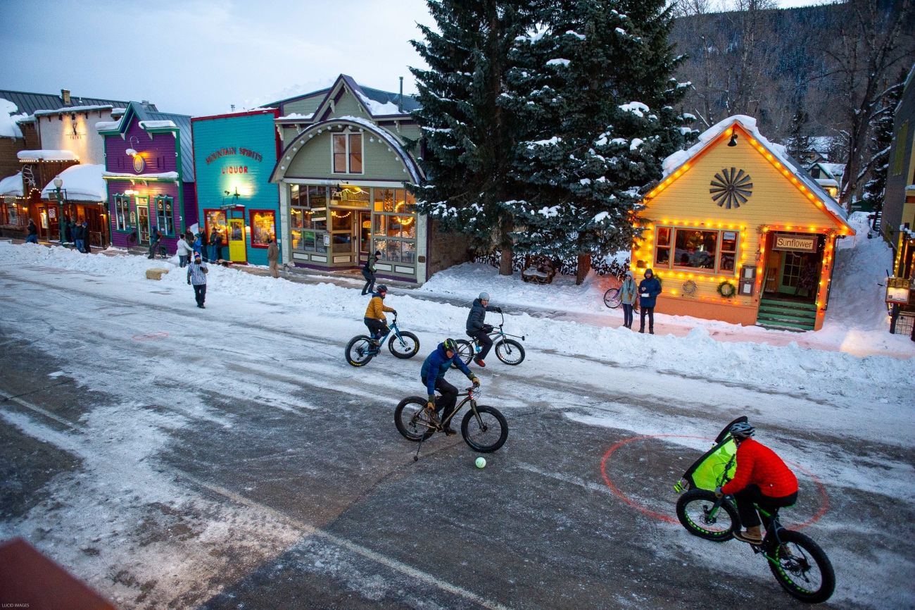 Yes, fat bike polo is a thing. At least it is now. The objective was put the ball in the goal — and try to stay upright on a very slick, closed off section of Elk Avenue in downtown Crested Butte, Colorado. Photo by Robby Lloyd/Lucid Images