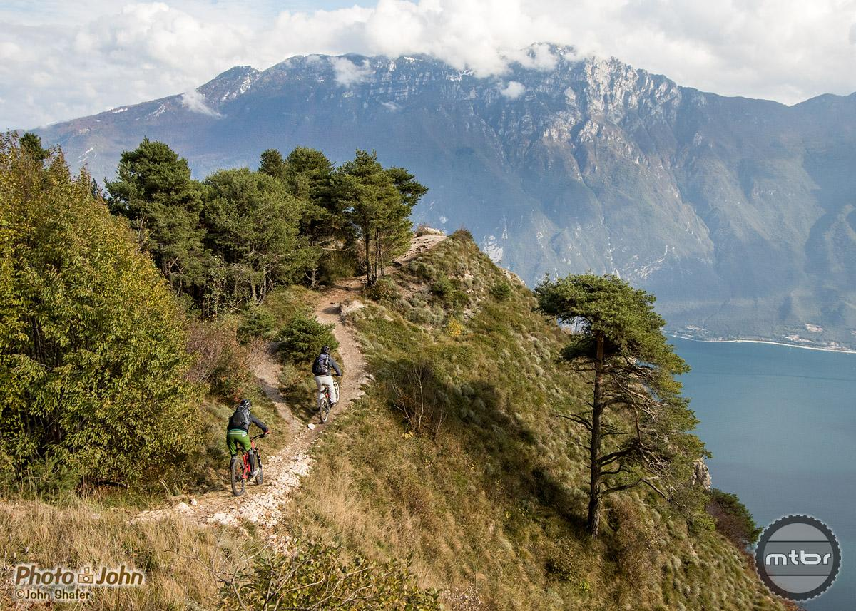 A classic view of Lago di Garda from the mid-point of the Tremalzo Pass descent. Riders: Collin and Judith McMahon.