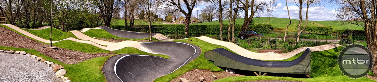 The headquarters has a manicured pump track by the building.
