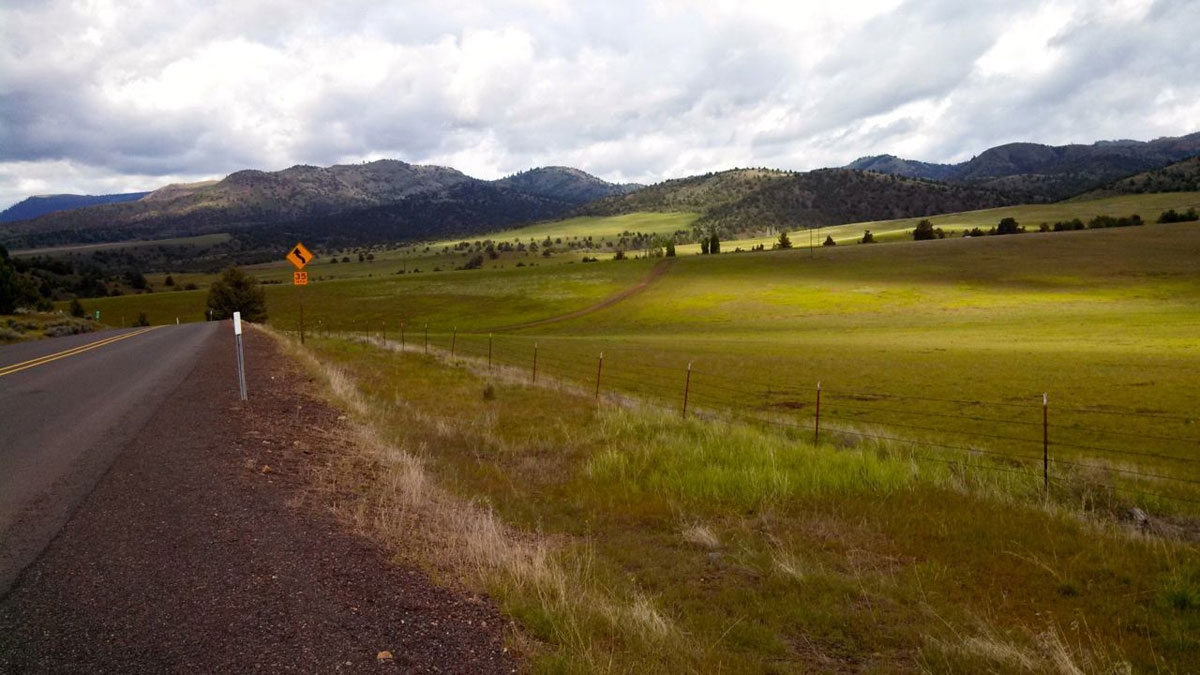 After 11 miles of climbing out of Girds Creek, the route crests verdant grasslands before descending the final half dozen miles into Mitchell.