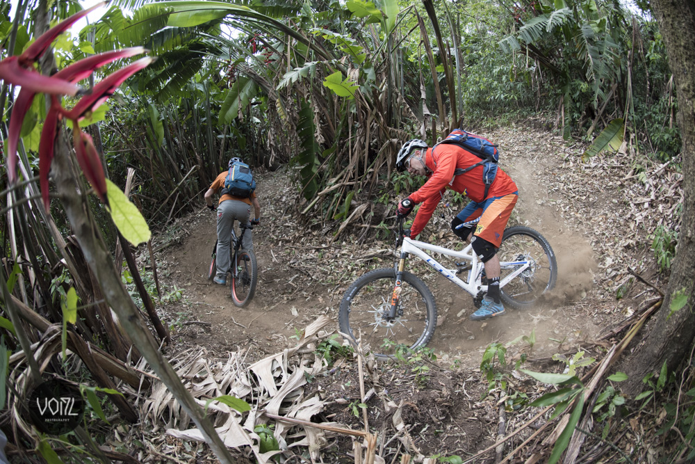 Tom and Hans ride through the Guatemalan jungle.
