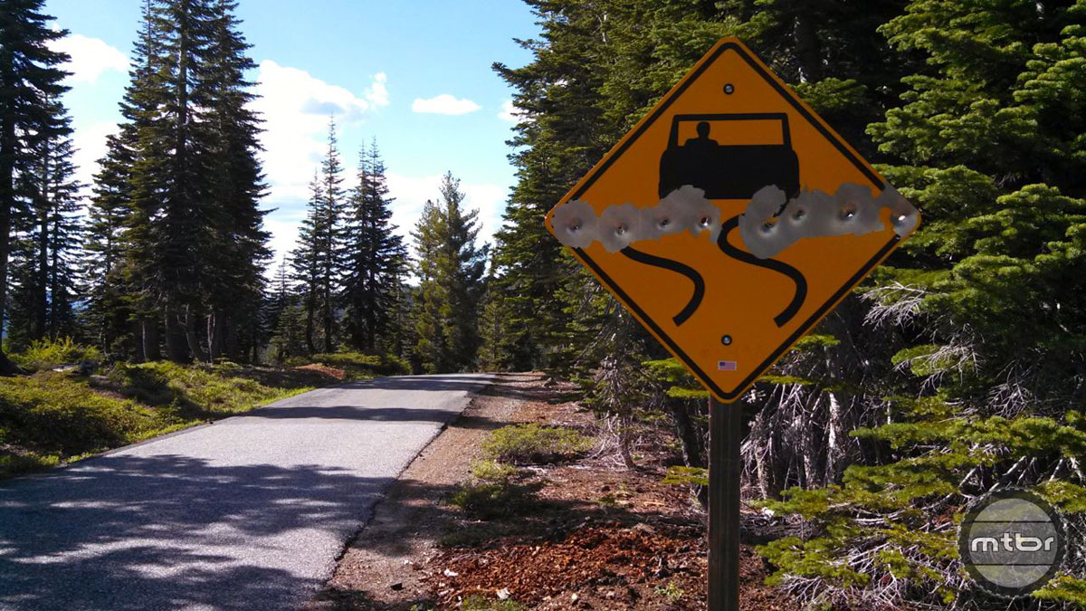 Bullet riddled road sign at the top of Packer Saddle.