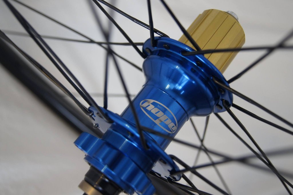 Lets see some blinged out wheelsets..I9,CK,Hope..anything goes!-hubsessed-cycle-works-blue-hope-gold-qr.jpg