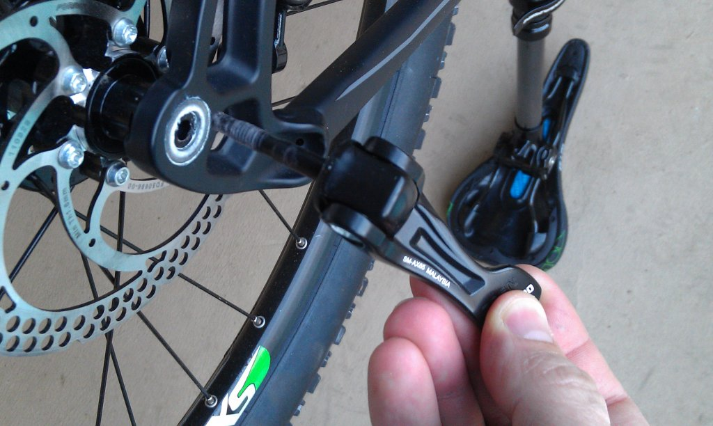 Can't remove rear wheel on 2013 XM 7-imag0048.jpg
