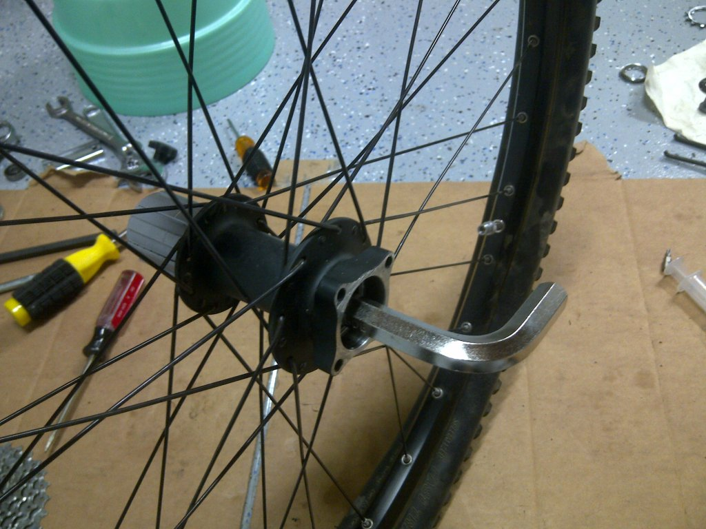 How do I take out the cartridge bearing from my rear hub (Coda