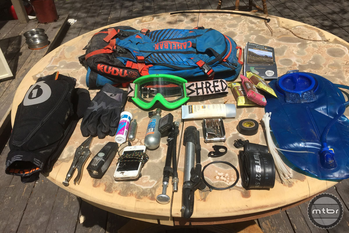 Ben Cruz's go to set-up, which includes a tube, pump, spare derailleur hanger, Powerlink, multi tool, and much more.