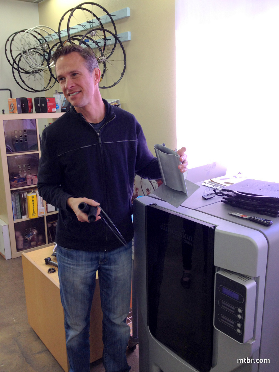 Founder Clark showing off his favorite toy, the 3D printer