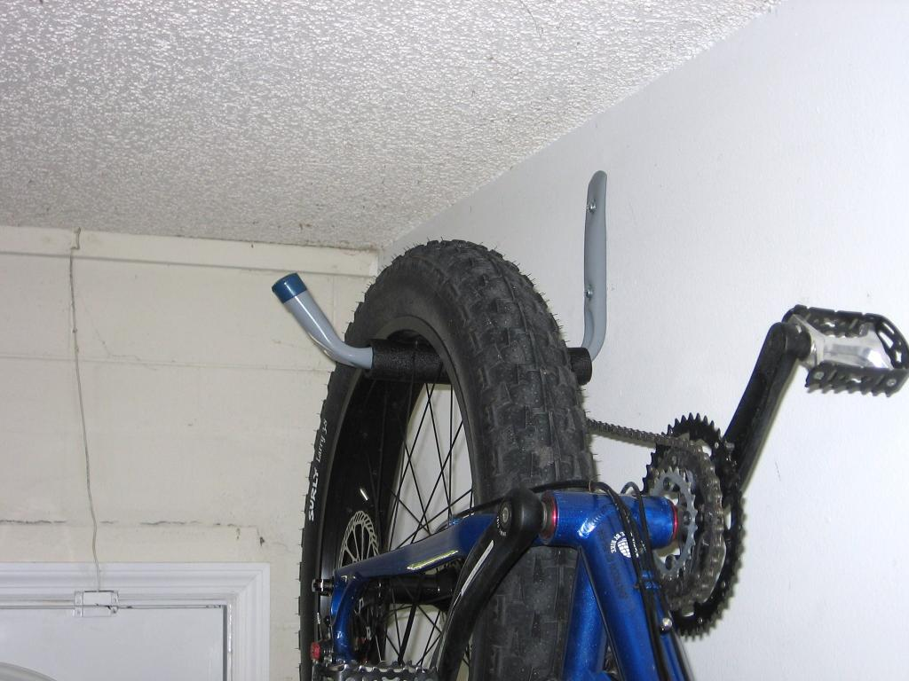 how bike your bikes in a to metal design the for high garage rack black designs hang