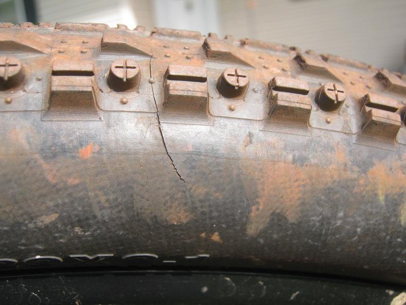 C shaped tire cracks on low milage Maxxis CrossMark-img_7058_1.jpg