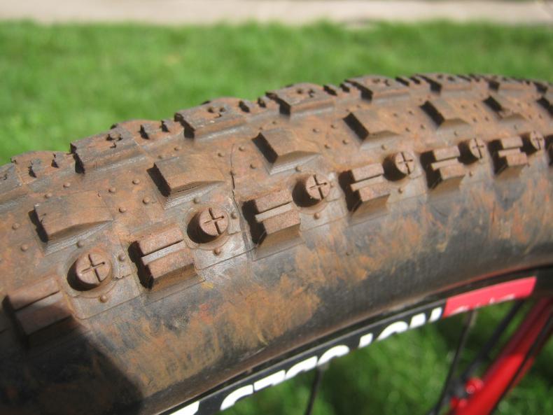 C shaped tire cracks on low milage Maxxis CrossMark-img_7059_1.jpg
