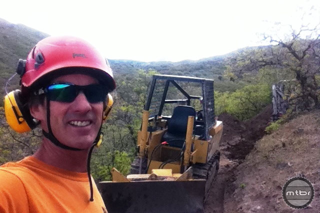 In the days leading up to SCOTT's dig day, IMBA Trail Specialist Joey Klein started the project with a small bulldozer. Photo by Joey Klein/IMBA