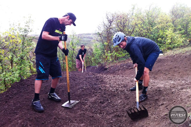 SCOTT's crew makes progress shaping a roller on the Rush trail. Photo by Joey Klein/IMBA