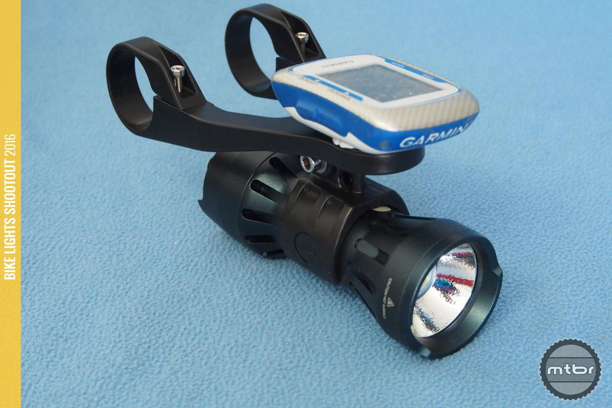 The Indigo INDIGO5 has a mount that places the light centrally and allows a Garmin.