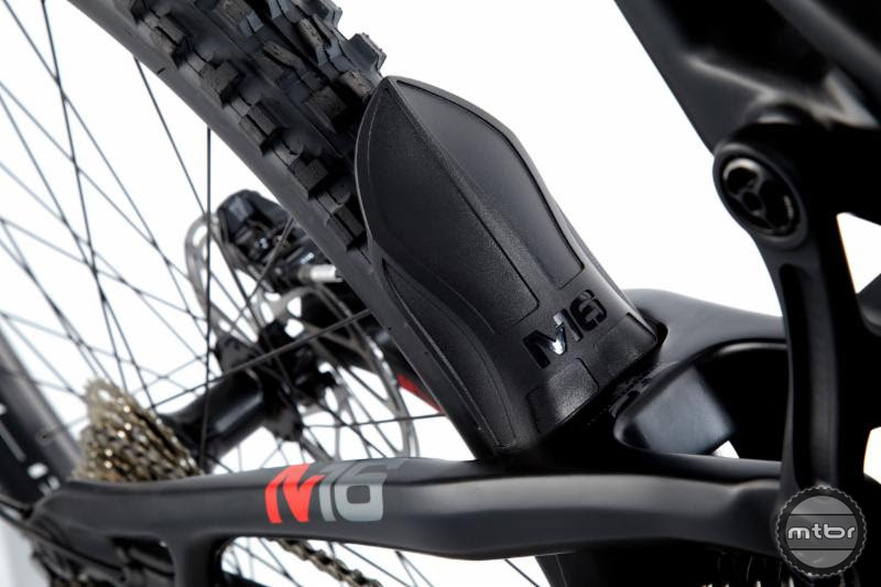 There are custom carbon protectors at the bottom bracket and chain stays, plus a mud guard.